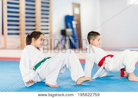 Children in Martial Arts Training indoors toned image color image
