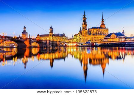 Dresden Germany. Cathedral of the Holy Trinity or Hofkirche Bruehl's Terrace. Twilight sunset on Elbe river in Saxony.