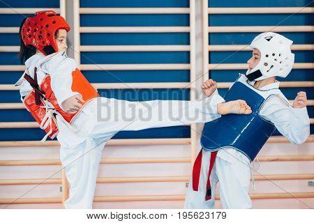 Taekwondo Kids Sparring on training indoors toned image color image