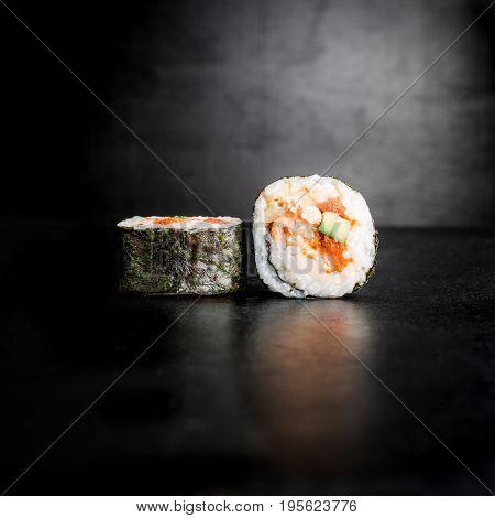 Sushi rolls on black background. Traditional  japan food.