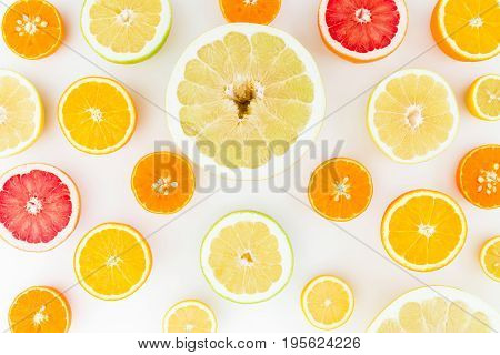 Citrus fruits background made of lemon, orange, grapefruit, sweetie and pomelo on white background. Flat lay, top view.