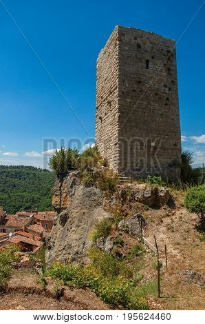 Panoramic view of tower on top of hill in a sunny day and Châteaudouble underneath, a quiet and tourist village with medieval origin. In the Var department, Provence region, southeastern France