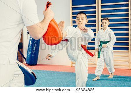 Taekwondo training for children on training indoors toned image color image