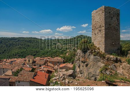 Panoramic view of tower on top of hill with Châteaudouble underneath, a quiet and tourist village with medieval origin. Located in the Var department, Provence region, southeastern France