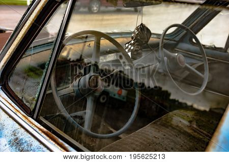 Peering inside of a vintage driver's education car through the driver's side window