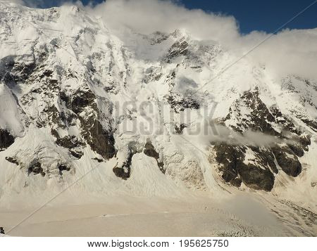 Power of nature. Real huge avalanche comes from a big mountain Shkhara, 5, 193 m , Caucasus, Kabardino-Balkaria, Bezengi region, Russia
