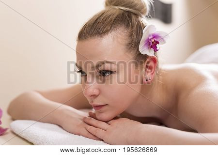 Woman lying in a beauty parlour enjoying relaxing beauty spa day at a wellness getaway