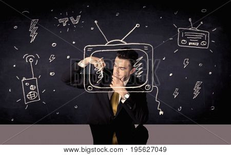 An elegant happy businessman drawing a television around his face, dreaming about becoming a famous actor or a programme presenter concept