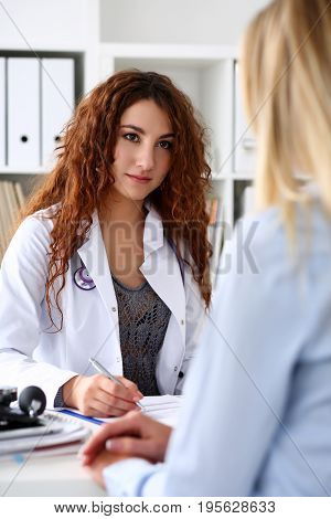 Beautiful Smiling Female Doctor Talk With Patient