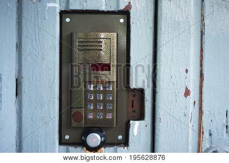 Intercom system on the door closeup photo