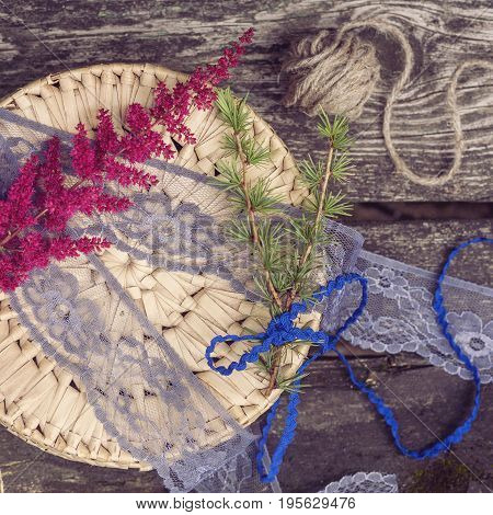 stillife with decorative materials ribbons and box on wooden background