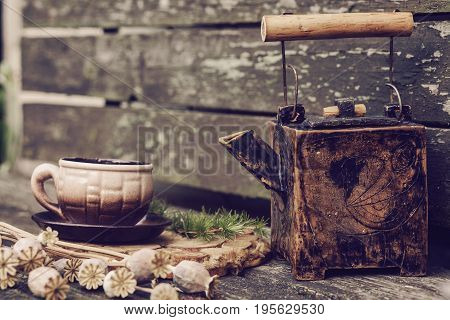 country house stillife with utensils and flowers poppies on a wooden background