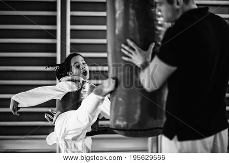 Taekwondo Class For Children On Training Indoors, Black And White Image