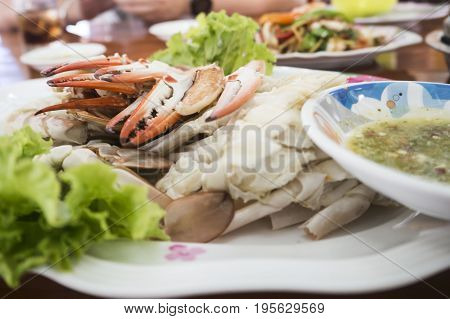 Claw crab cracked in a plate on the table