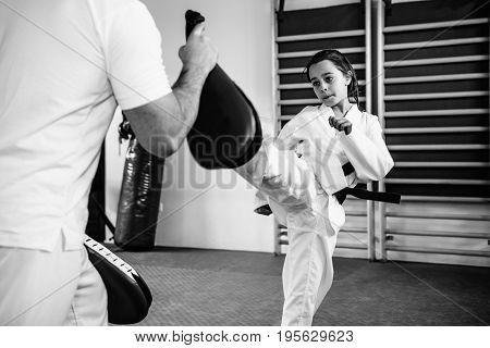 Taekwondo Instructor Working With Little Girl On Training Indoors, Black And White Image