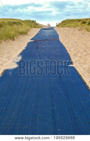 PROVINCETOWN-SEPTEMBER 15: Blue carpet with sand early morning near beach in Provincetown, Cape Cod , Massachussets, USA on September  15, 2014.