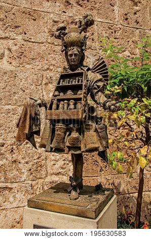Grasse, France - July 12, 2016. View of Bronze statue of perfume seller the city center of Grasse, known for producing perfumes. Alpes-Maritimes department, Provence region, southeastern France