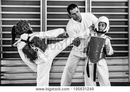 Taekwondo class on training indoors black and white image