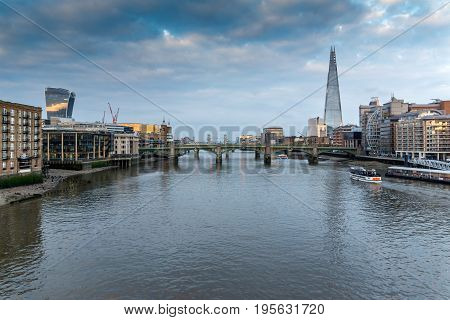 LONDON, ENGLAND - JUNE 18, 2016: Amazing sunset Cityscape from Millennium Bridge and Thames River, London, Great Britain