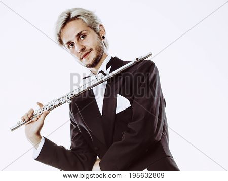 Male Flutist Wearing Tailcoat Holds Flute