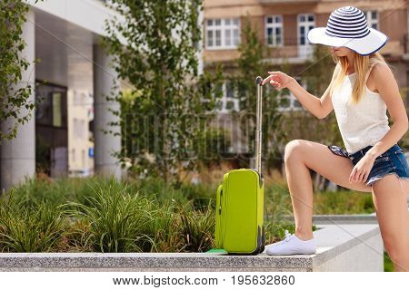 Attractive Woman Tourist With Suitcase Ready To Travel