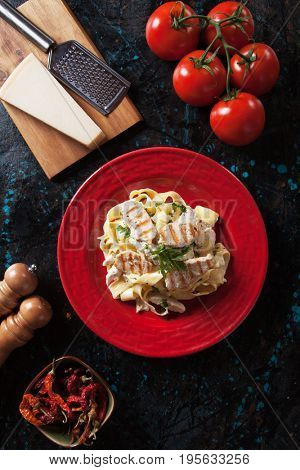 Italian fettuccine alfredo pasta with grilled chicken