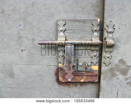 Rusty padlock on an old wooden door of the indian house
