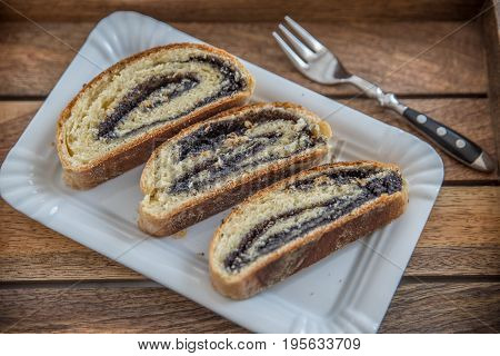 home made yeast strudel filled with poppy seeds