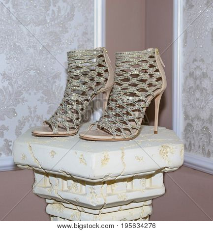 fashion footwear. Biege high heel shoes. glamour