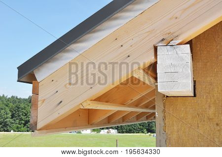 Unfinished House Roof Corner with Wall Insulation. Attic Construction and Attic Insulation.