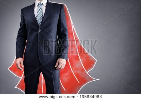 Superhero businessman with red cape drawing on background concept for leadership