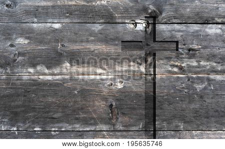 Brown old christian religion symbol cross shape as sign of belief on a grungy textured church wall or rustic aged background or backdrop, copy space for conceptual spirituality or resurrection design