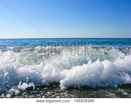 ripples wave nibble on sand beach air bubbles see ocean abstract