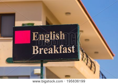 English Breakfast signboard on the cafe in the street.