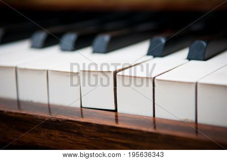 Individuality concept of a piano key standing out from others