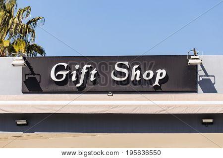 Gift shop sign on a building, inscription