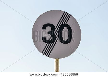 Traffic sign End of maximum speed limit zone.