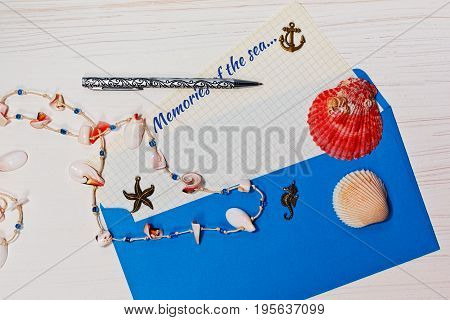 Vacations letter concept message from the sea blue envelope sea shells and tagline
