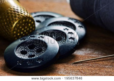 Close up handicraft hone sewing hobby concept in retro style on wooden background soft focus