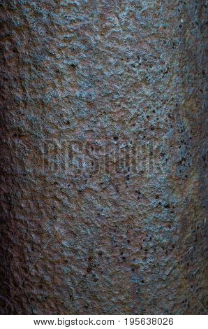 The textured background of old rusty metal closeup