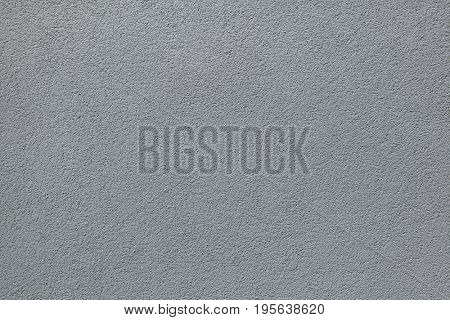 Grey painted stucco wall. Background texture.