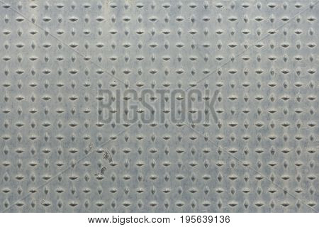 Metal panel covered with rhombic pattern. Background texture.