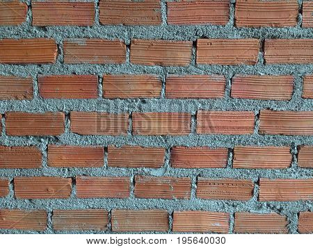 Brown bricks and cement wall texture, background