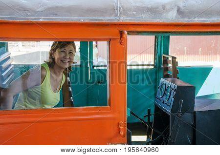 Woman Inside Litorina On Estrada De Ferro Madeira-mamore Railroad In Porto Velho Ro