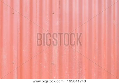 Red Metal Wall, Industrial Wall With Some Ripples And Screws