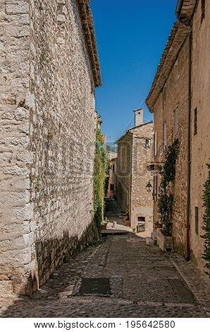 Saint-Paul-de-Vence, France - July 13, 2016. Stone house with shop and bindweed in the Saint-Paul-de-Vence village, stunning medieval town completely preserved. In Provence region, southeastern France