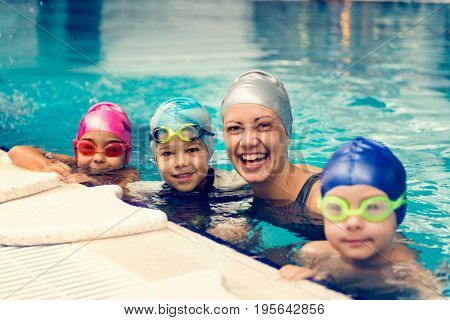 Group Swimming Lesson For Children On Indoor Swimming Pool, Toned Image