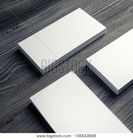 Photo of blank business cards on a wooden background. Template for ID. Business cards mockup.