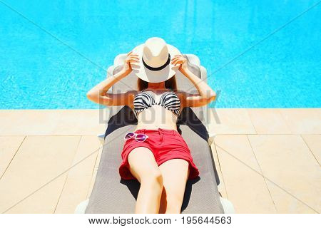 Summer Holidays - Woman Lying Resting On A Deckchair, Blue Water Pool Background