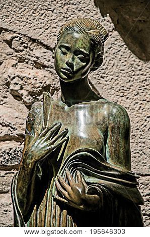 Saint-Paul-de-Vence, France - July 13, 2016. Close-up of woman statue in stone in Saint-Paul-de-Vence, stunning medieval town completely preserved. In Provence region, southeastern France